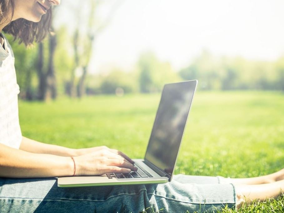 Woman in park on a laptop