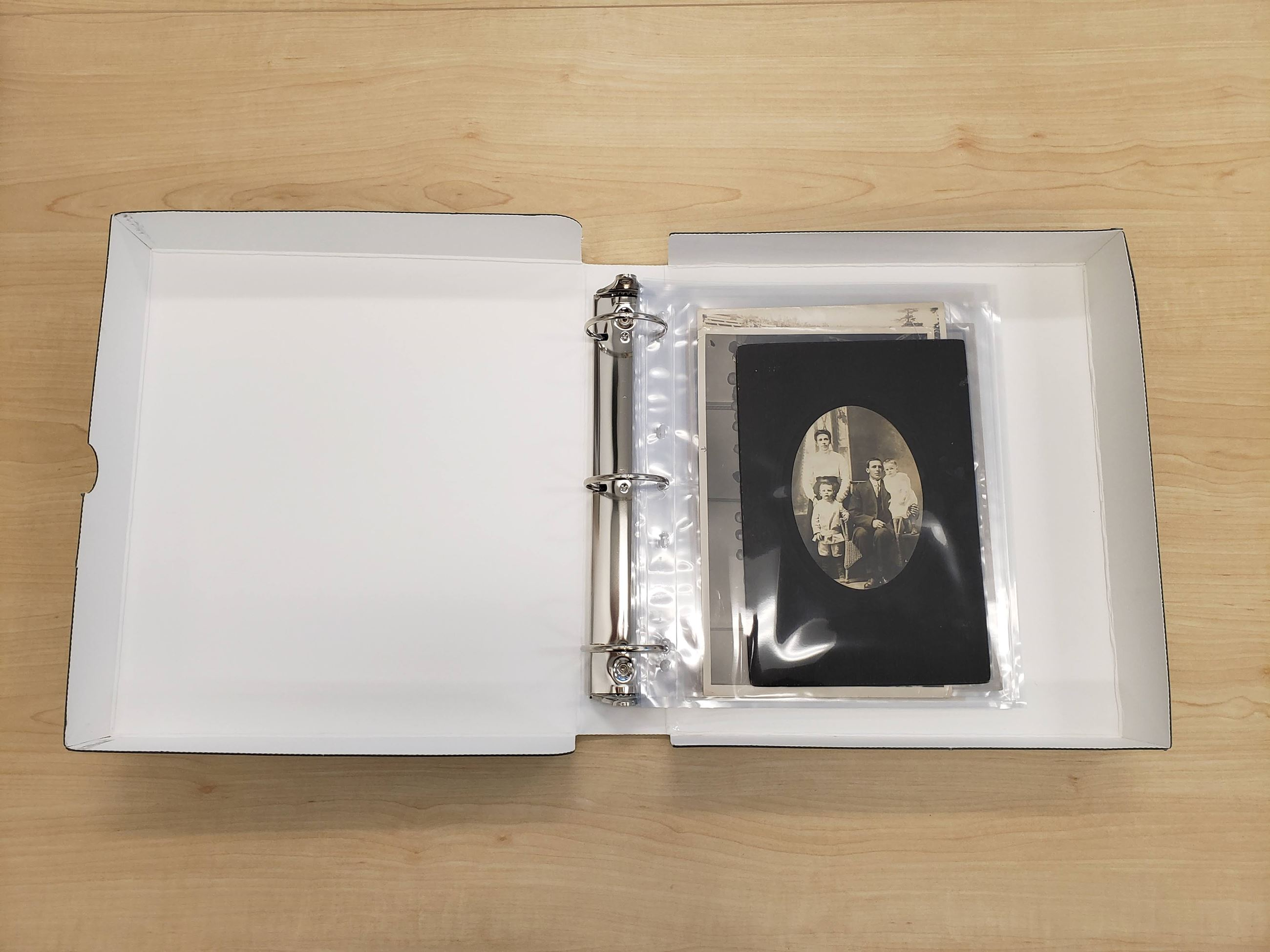 28 - Archival binder with plastic photo sleeves (Harris Family fonds, City of Coquitlam Archives)