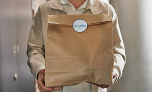 Paper Bag Containing Meals for Seniors